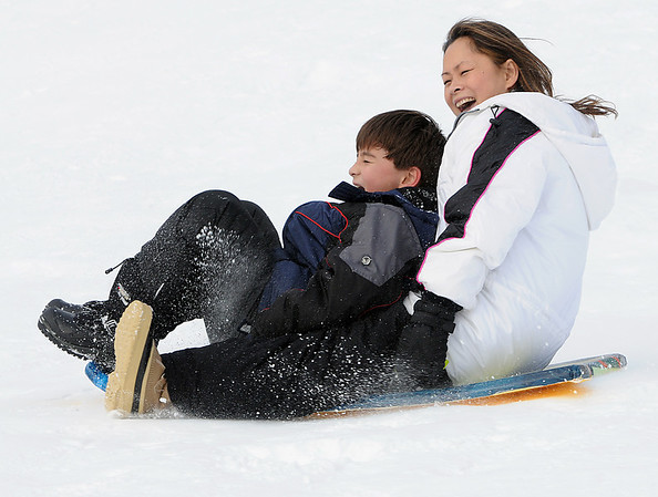 Beverly:<br /> Mary Ann Archibald and her son, Lucas, 8, scream as their sled turns sideways while traveling downhill at Lynch Park in Beverly. <br /> Photo by Ken Yuszkus/Salem News, Friday, January 14, 2011.
