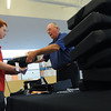 Beverly:<br /> Nick Alpine, an incoming junior, receives a laptop computer from Bryan Dunlavey, of Crest Technologies, Inc., at Beverly High School on Monday morning.<br /> Photo by Ken Yuszkus/Salem News, Monday, August 15, 2011.