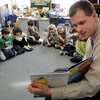 "Wenham:<br /> Bryan Menegoni, assistant principal at Hamilton-Wenham High School, reads ""The Lorax"", by Dr. Seuss, to Jeannie Knox's full day kindergarten class at the Buker School. He was one of the community readers participating in the Read Across America celebration at the school.<br /> Photo by Ken Yuszkus/Salem News, Thursday, March 17, 2011."