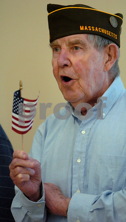 Peabody:<br /> Bill Flanagan sings God Bless America along with the other veterans standing in front of the hall at the Torigian Life Center during the AARP Memorial Day Observance ceremony. He is a U.S. Army veteran that served in WWII from 1943 to 1946.<br /> Photo by Ken Yuszkus/Salem News, Tuesday May 19, 2009.