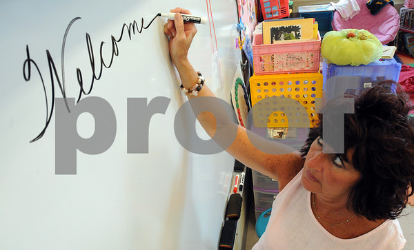"""Peabody:<br /> Bradlee Tattan, 4th grade teacher, writes """"welcome back"""" on the board in her class at the Thomas Carroll School. Peabody had the first day of school on Monday.<br /> Photo by Ken Yuszkus/Salem News, Monday, August 31, 2009."""