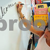 "Peabody:<br /> Bradlee Tattan, 4th grade teacher, writes ""welcome back"" on the board in her class at the Thomas Carroll School. Peabody had the first day of school on Monday.<br /> Photo by Ken Yuszkus/Salem News, Monday, August 31, 2009."
