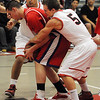 Salem:<br /> Salem's Bradley Skeffington tries to regain possession of the ball during the Burlington at Salem boys basketball game in first round of Division 2 North state playoffs.<br /> Photo by Ken Yuszkus/Salem News, Tuesday, March 1, 2011.