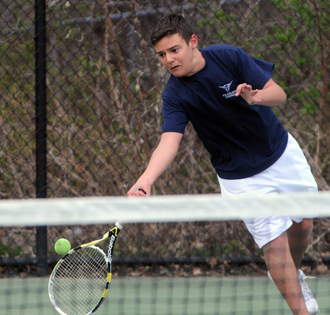 Swampscott:<br /> Peabody's Mike Nicoli hits a low ball during the Peabody at Swampscott boys tennis match at Swampscott Middle School tennis courts.<br /> Photo by Ken Yuszkus/Salem News, Monday, April 9, 2012.