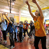 "Ipswich:<br /> Alice Thornton, of Rowley, right, front row, practices the dance moves for the African Dance which was later performed in the Ipswich YMCA gymnasium as part of the ""Wild and Crazy Days"" events on Tuesday afternoon.<br /> Photo by Ken Yuszkus/Salem News, Tuesday, April 19, 2011."