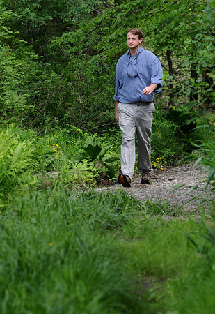 Topsfield:<br /> Alex Van Alen, Executive Director of Essex County Trails walks on a trail in Bradley Palmer State Park.<br /> Photo by Ken Yuszkus/Salem News, Thursday, May 27, 2010.