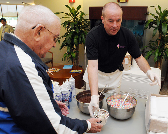 Danvers:<br /> James Pasquale, left, accepts a free ice cream sundae from Tom Gould at the Mass. General, North Shore Cancer Center.<br /> Photo by Ken Yuszkus/Salem News, Monday, June 13, 2011.