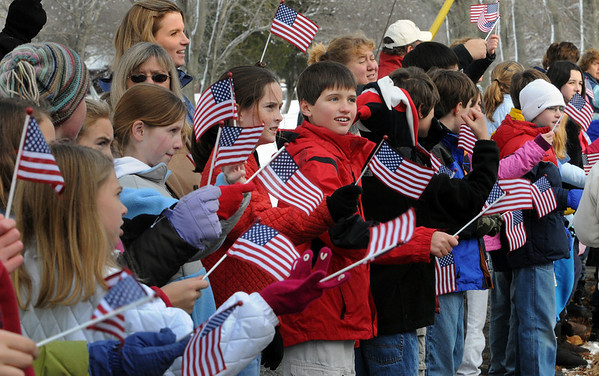 Hamilton:<br /> The Wreaths Across America convoy passes the Winthrop School students waving small flags on Route 1a as the convoy enters Hamilton. The convoy stopped briefly in town while on it's way to Arlington National Cemetery.<br /> Photo by Ken Yuszkus/Salem News, Monday, Decmber 7, 2009.