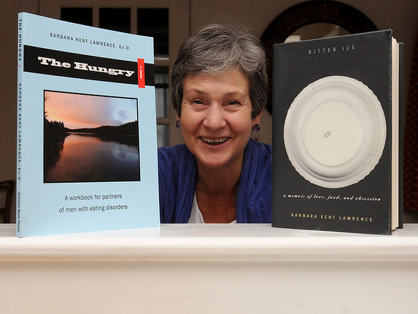 Hamilton:<br /> Barbara Kent Lawrence has written a book about her husband's anorexia, belemia and alcoholism, and the struggles she faced with his disorders. She is pictured with the two books she wrote, The Hungry i and the Bitter Ice.<br /> Photo by Ken Yuszkus/Salem News, Thursday, March 10, 2011.