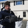 Beverly:<br /> Patrick Collett stands in front of his home explaining his plight of not having electricity for hours during the cold snap Monday morning.<br /> Photo by Ken Yuszkus/Salem News, Monday, January 24, 2011.
