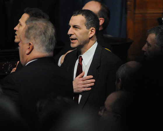 Boston:<br /> Jerry Parisella helps lead in the pledge of allegiance before he was sworn in as Beverly's new state representative at the Statehouse.<br /> Photo by Ken Yuszkus/Salem News, Wednesday, January 5, 2011.