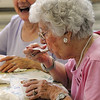 Salem:<br /> Louise LeClair, right, has a spoonful of her ice cream sundae. Doma Ingemi, left, is also eating ice cream. The Salem Council on Aging hosted an ice cream social sponsored by Ben & Jerry's Ice Cream and state Rep. John Keenan at the Senior Center. It was part of Salem's Heritage Days. <br /> Photo by Ken Yuszkus/Salem News, Monday, August 8, 2011.
