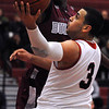 Salem:<br /> Salem's Antonio Reyes goes up for a shot at the basket during the Lynn English at Salem High School boys basketball game for the Northeastern Conference title.<br /> Photo by Ken Yuszkus/Salem News, Tuesday, February 15, 2011.