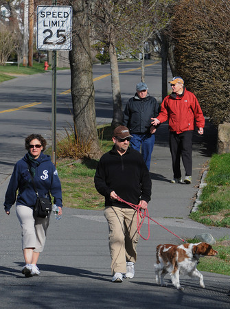 Beverly:<br /> Jean and Randall Sword and their dog, Louie, walk along Corning Street in Beverly as part of the 33rd annual Good Friday Walk, which raises money to help needy families on the North Shore.<br /> Photo by Ken Yuszkus/Salem News, Friday, April 6, 2012.