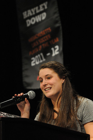 Peabody:<br /> Hayley Dowd speaks at the podium in front of her banner after receiving her Gatorade State Athletes of the Year trophy at the Peabody Veterans Memorial High School. Catarina Rocha also won the award.<br /> Photo by Ken Yuszkus/Salem News, Wednesday,  March 14, 2012.