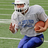 Danvers:<br /> Tyler Coppola runs with the ball during  drills at practice at St. John's Prep.<br /> Photo by Ken Yuszkus/Salem News, Wednesday,  September 8, 2010.