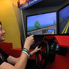 Beverly:<br /> Haley Sciolo text messages while using the driving simulator as instructor Topher Paone watches her reactions.<br /> Photo by Ken Yuszkus/Salem News, Monday, July 11, 2011.