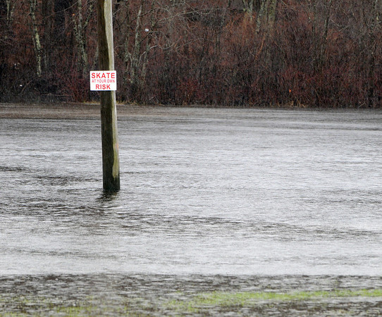 Topsfield:<br /> Water floods part of the Topsfield Fair grounds near Route 1.<br /> Photo by Ken Yuszkus/Salem News, Monday, March 29, 2010.