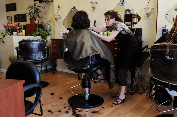 Beverly:<br /> Cala Renee Mahoney, owner of Cala Renee Salon, cuts the hair of Angela Cassano, of Lynnfield, at her shop. Cala Renee is donating cut hair that will be used to help soak up the oil in the Gulf Coast oil spill.<br /> Photo by Ken Yuszkus/Salem News, Tuesday, May 4, 2010.