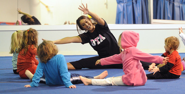 Swampscott:<br /> Jennifer Burke, owner of Burke's Tumbling Academy, does warm up exercises with the children before the teaching the class of 3- and 4-year-olds <br /> Photo by Ken Yuszkus/Salem News, Monday, January 3, 2011.