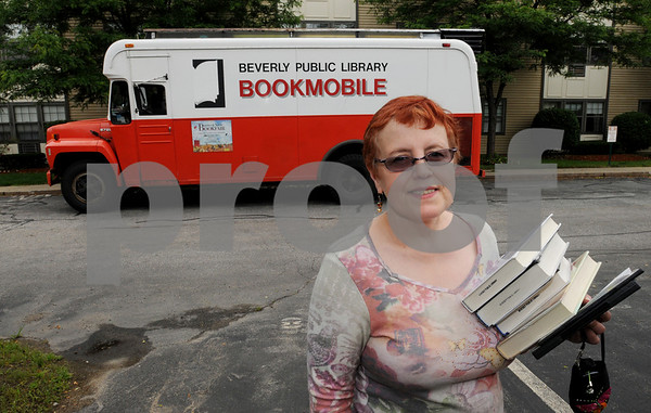 Beverly:<br /> Linda Caravaggio has driven the bookmobile for over twenty years.<br /> Photo by Ken Yuszkus/Salem News, Thursday, June 25, 2009.