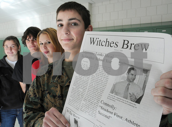 Salem:<br /> From left, Madeleine Lutts, writer, Jimmy Towey, co-editor, Shannon Ferguson, co-editor, and Joe Smith, editor, all seniors at Salem High School, with the new issue of the school newspaper, Witches Brew. Many other students worked on the newspaper as well.<br /> Photo by Ken Yuszkus/Salem News, Wednesday November 20, 2008.