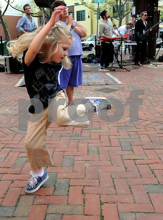 Salem:<br /> Leah Truncale, 4, of Peabody, has her own style of dancing to the music performed by the Cole Degenova and the Peoples Republic band during the Salem Jazz and Soul Festival.<br /> Photo by Ken Yuszkus/Salem News, Saturday May 9, 2009.