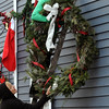 Salem:<br /> Rhonda Canillas, left, helps her sister, Anita Armell,  hang a Christmas wreath on their home on Hawthorne Boulevard on Monday morning.<br /> Photo by Ken Yuszkus/Salem,  News, Monday,  December 13, 2010.