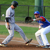 Lynn:<br /> North Shore Navigators' Rob Krentzman waits for the throw from the pitcher, Bobby Dean, as  Brockton Rox's  Vito Perna gets back to first base safely in a pick off try during the Brockton Rox at North Shore Navigators baseball game held at Fraser Field.<br /> Photo by Ken Yuszkus/Salem News, Thursday, July 5,  2012.