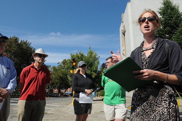 Salem:<br /> Dr. Elizabeth Duclos-Orsello, far right, starts the walking tour in front of the former St. Joseph's Church on Lafayette Street on Sunday.<br /> Photo by Ken Yuszkus/Salem News, Sunday, September 11, 2011.