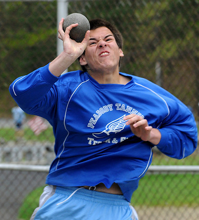 Peabody:<br /> Peabody's Brandon Quach throws the shot put during the Salem at Peabody High co-ed outdoor track meet.<br /> Photo by Ken Yuszkus/Salem News, Tuesday, May 10, 2011.