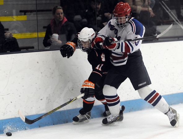 North Billerica:<br /> Mitch Hamor gets squeezed against the boards while going after the puck during the Beverly High School boys hockey game in Division 2 North semifinals vs Tewksbury at the Chelmsford Forum hockey rink.<br /> Photo by Ken Yuszkus/Salem News, Tuesday March 8, 2011.