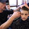 Beverly:<br /> Steven Brown has the Patriots logo and the number 12 cut into his hair and colored by barber Ward Arthur, co-owner of Sportsmen Barber Shop in Beverly. His twin brother, Jack, watches with his parents, Nancy and Dan. Jack also had the same haircut.<br /> Photo by Ken Yuszkus/Salem News, Tuesday, February 1, 2012.