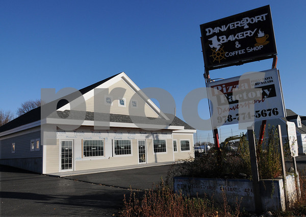 Danvers:<br /> The signs for the Danversport Bakery and Coffee Shop and the Pizza Factory near a newly constructed building on Route 35 in Danversport two years after the explosion rocked the neighborhood.<br /> Photo by Ken Yuszkus/Salem News, Tuesday November 19, 2008.