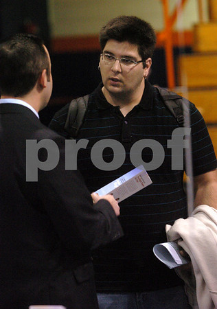 Salem:<br /> Dustin Quadros of Middleton,  a senior at Salem State College, talks with Brian Freitas from Wells Fargo Financial at the job fair at the college.<br /> Photo by Ken Yuszkus/Salem News, Monday, March 30, 2009.