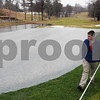 Ipswich:<br /> Evan Heenehan, assistant golf course supervisor, walks near the tenth green which is seeded and covered at the Ipswich Country Club.<br /> Photo by Ken Yuszkus/Salem News, Friday, April 3, 2009.