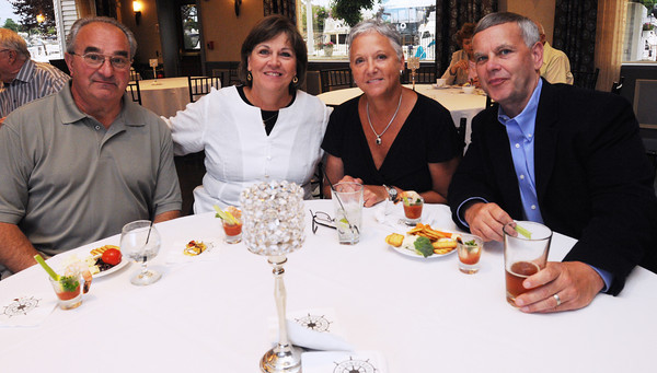 Danvers:<br /> From left, inlaws of Nelson Benton, Don and Lindsey Maihos, and Lisa and Rich Brown at Nelson Benton's retirement party which was held at the Danvers Yatch Club.<br /> Photo by Ken Yuszkus/Salem News, Wednesday, June 27,  2012.