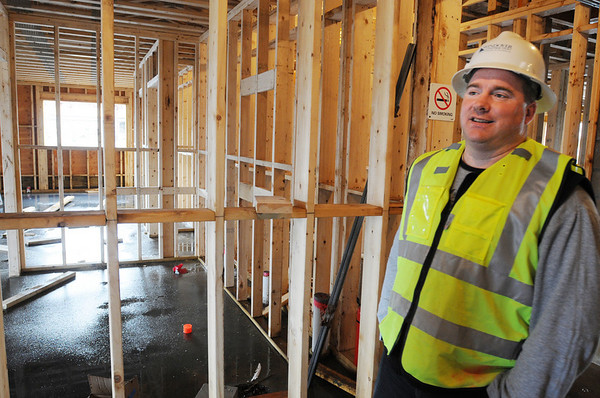 Ipswich:<br /> Brian Senk, superintendent at the construction site, is inside one of the two buildings of the affordable housing project under construction. It will be called Powder House Village.<br /> Photo by Ken Yuszkus/Salem News,  Wednesday,  November 17, 2010.