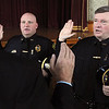 Peabody:<br /> From left, Tim Spanos, Peabody city clerk, Swears in two police sergeants, Eric Zawacki, and Robert Waugh, in Peabody City Hall on Thursday.<br /> Photo by Ken Yuszkus/Salem News, Thursday,  September 9, 2010.