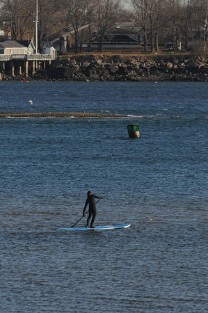 Salem:<br /> A man on a paddleboard fights the wind and the receeding tide in Salem Harbor Monday afternoon.<br /> Photo by Ken Yuszkus/Salem News, Monday, February 6, 2012.