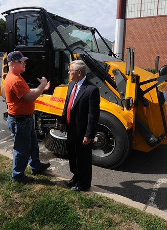 Peabody:<br /> Matt Legault, left, one of the drivers of the new street sweeper in the background, talks about the new machine with Peabody Mayor Michael Bonfanti at the Department of Public Service.<br /> Photo by Ken Yuszkus/Salem News, Thursday,  September 16, 2010.