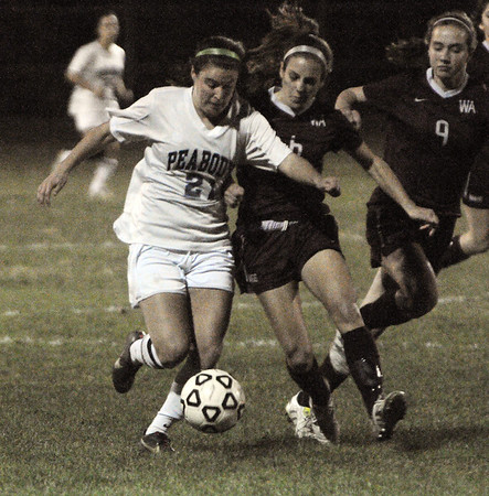 Peabody:<br /> Peabody's Hayley Dowd, left, brings the ball downfield under pressure during the Westford Academy at Peabody State tournament girls soccer game in Division 1 North.<br /> Photo by Ken Yuszkus/Salem News, Monday, November 7, 2011.