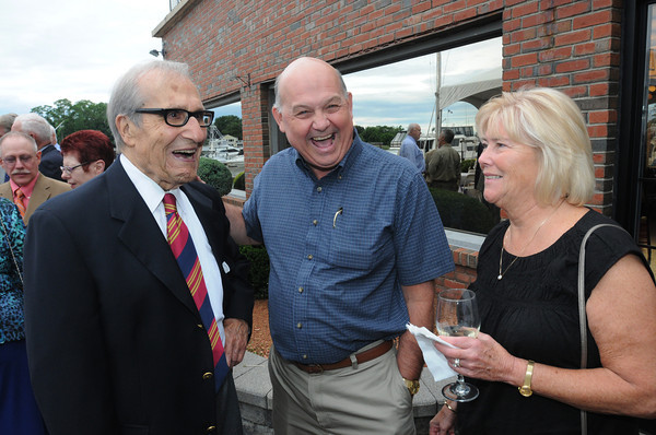 Danvers:<br /> From left, John Serafini, a good friend of Nelson Benton, Ken Newbegin, former co-publisher of The Salem News and good friend of Nelson, and his wife, Cathy, at Nelson Benton's retirement party which was held at the Danvers Yatch Club.<br /> Photo by Ken Yuszkus/Salem News, Wednesday, June 27,  2012.