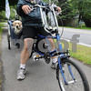 Wenham:<br /> Dan McCrady peddled his bicycle with his dog Sadie from Florida and will end in Maine. He was traveling through Wenham on Route 97.<br /> Photo by Ken Yuszkus/Salem News, Wednesday, June 10, 2009.