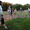 Beverly:<br /> Women do some stretching exercises at the beginning of the softball clinic at Harry Ball Field.  The Beverly softball team is teaming up with mothers to teach them how to bat and throw a ball in preparation for the upcoming Momball fundraiser.<br /> Photo by Ken Yuszkus/Salem News, Tuesday, September 15, 2009.