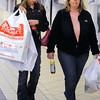 Danvers:<br /> Felicia DeFeo, left, with her mother, Christa Matheson, carry their bags of items purchased at the Liberty Tree mall on Black Friday.<br /> Photo by Ken Yuszkus/Salem News, Friday November 27, 2009.