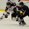Cambridge:<br /> Marblehead's Ty Bates gets a handle on the puck in the first period during the Marblehead vs Pembroke division 3 state semifinals at Bright Center at Harvard University.<br /> Photo by Ken Yuszkus/Salem News, Tuesday March 15, 2011.