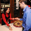 Salem:<br /> Suzanne Provencher, left, sells chances for prizes to Ben Arlander at the door during the Salem Children's Charity Annual Christmas Party held at Victoria Station restaurant.<br /> Photo by Ken Yuszkus/Salem,  News, Tuesday,  December 14, 2010.