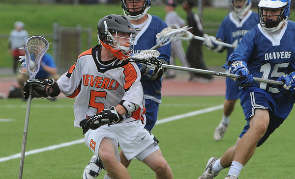 Beverly:<br /> Beverly's Dom Abate, left, runs with ball while being trailed by Danvers' Nick Strangie, during the Danvers at Beverly boys lacrosse game.<br /> Photo by Ken Yuszkus/Salem News, Monday, April 23, 2012.