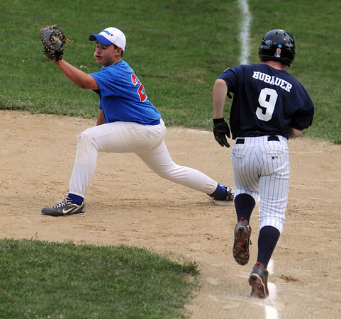 Salem:<br /> Swampscott's Matt Hubauer is out at first base as Danvers' Corey Crossley during the Gallant Memorial youth baseball tournament final at Forest River Park, Salem between Danvers and Swampscott.<br /> Photo by Ken Yuszkus/Salem News, Tuesday August 17, 2010.